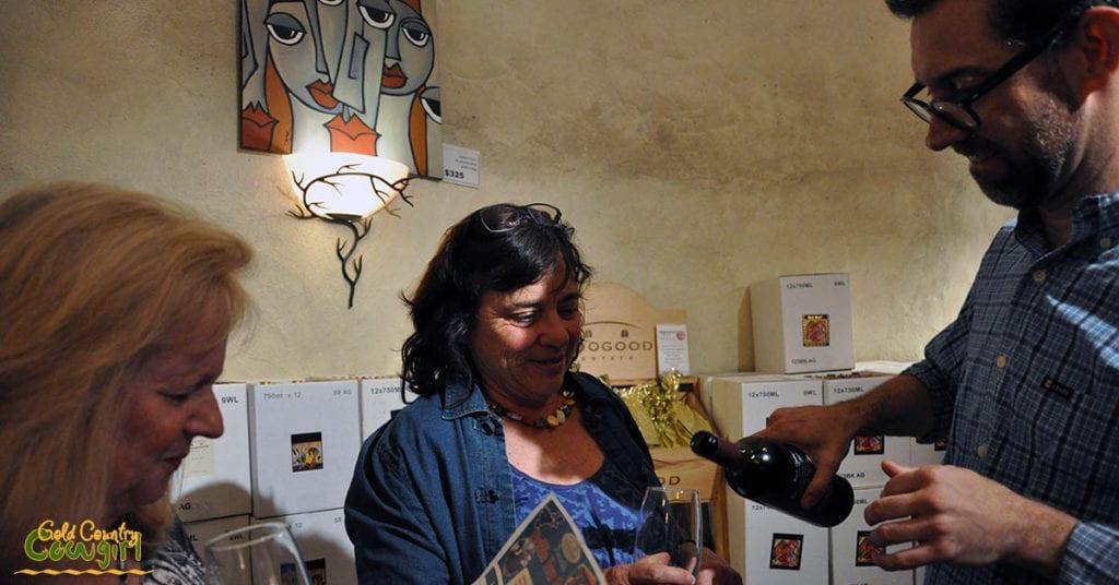 Dane pouring for Denise