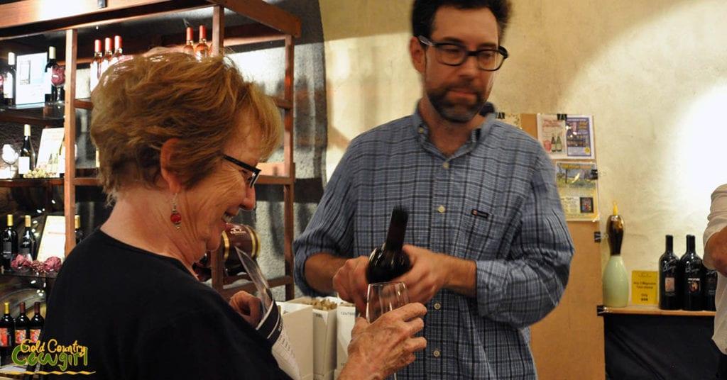 Dane pouring for Linda