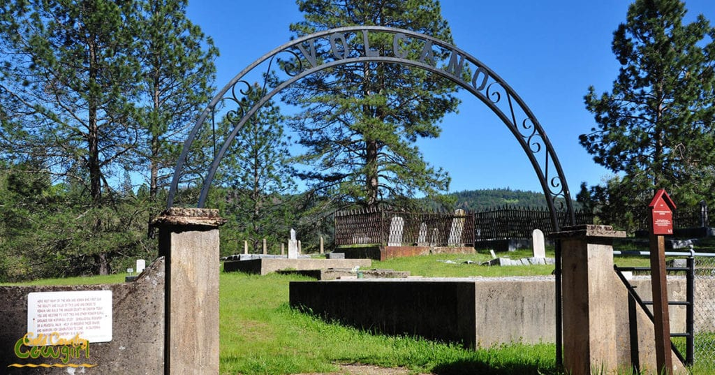 entrance to cemetary with headstones in background