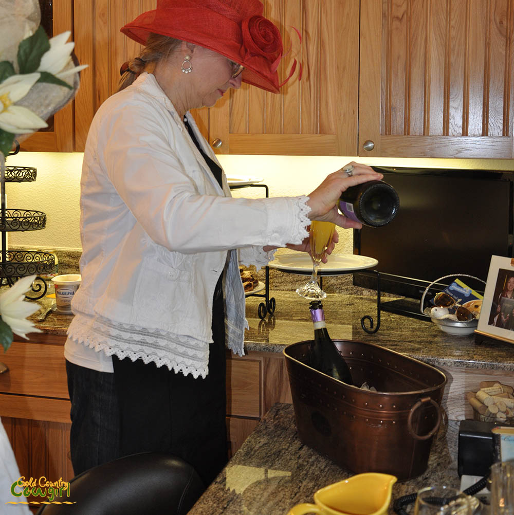 Beverage station at tea party with juice and champagne