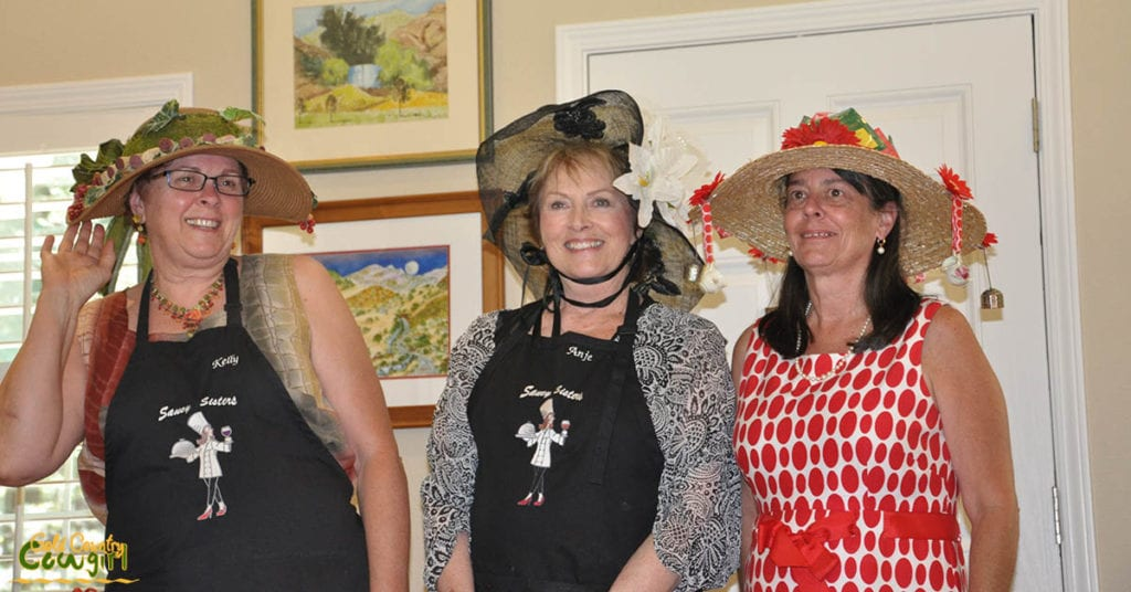 The top three hats picked by the hostesses being judged