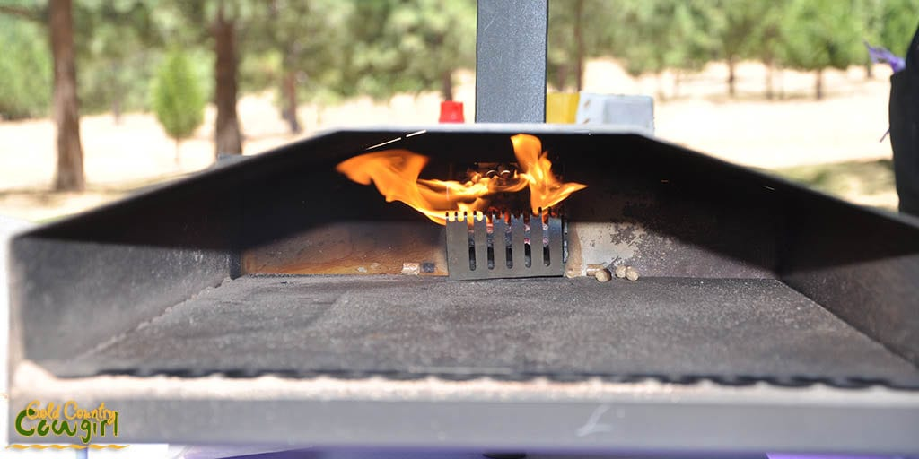 Flame inside the outdoor pizza oven as it heats up