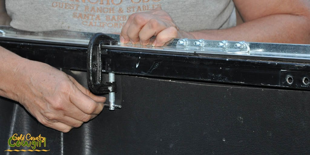 attaching the rail to the truck with clamps