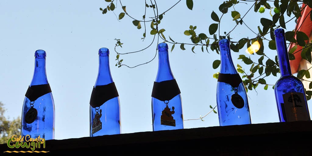 blue-bottles-in-window