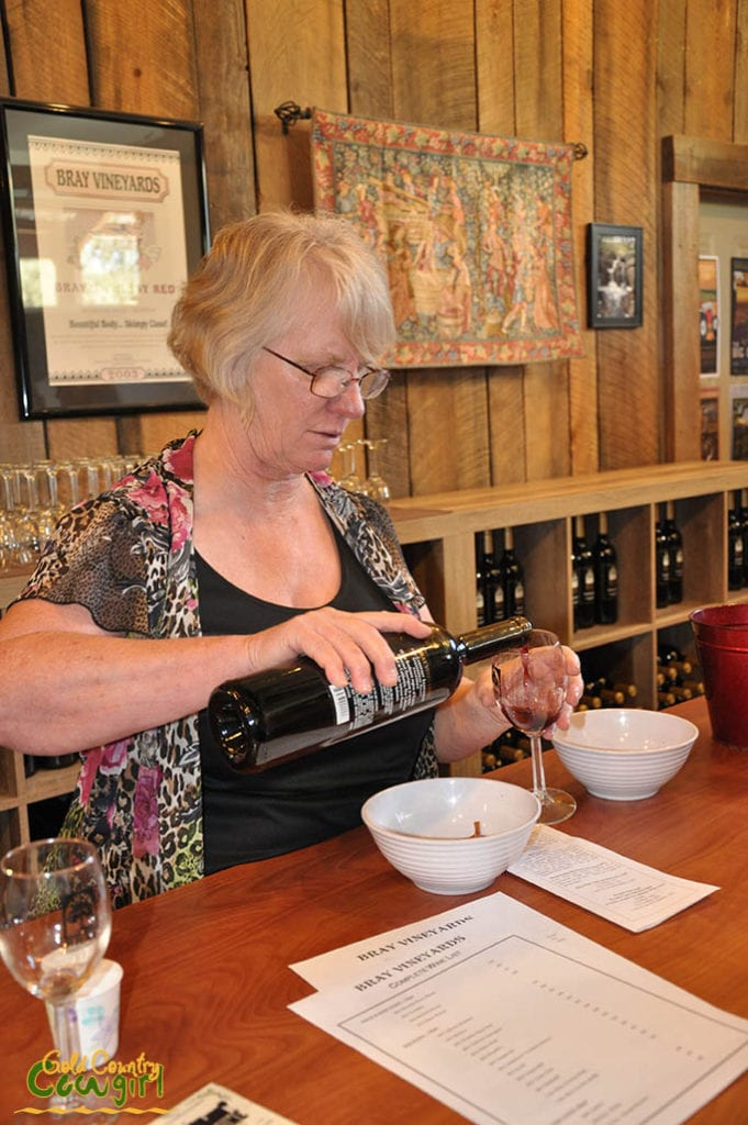 Kathy pouring wine