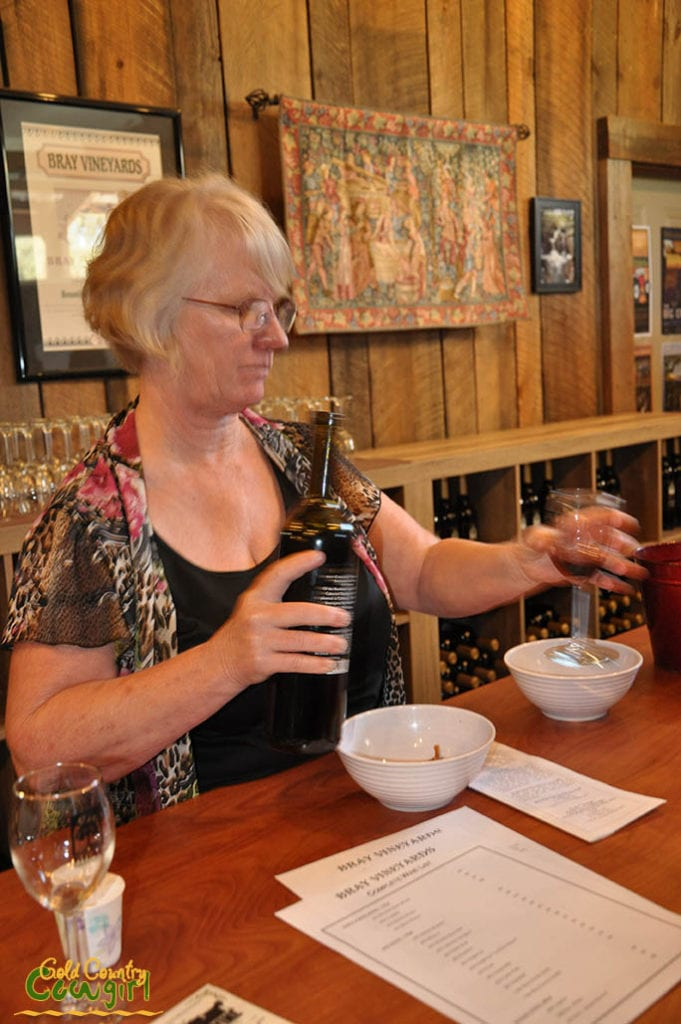Kathy pouring wine 2