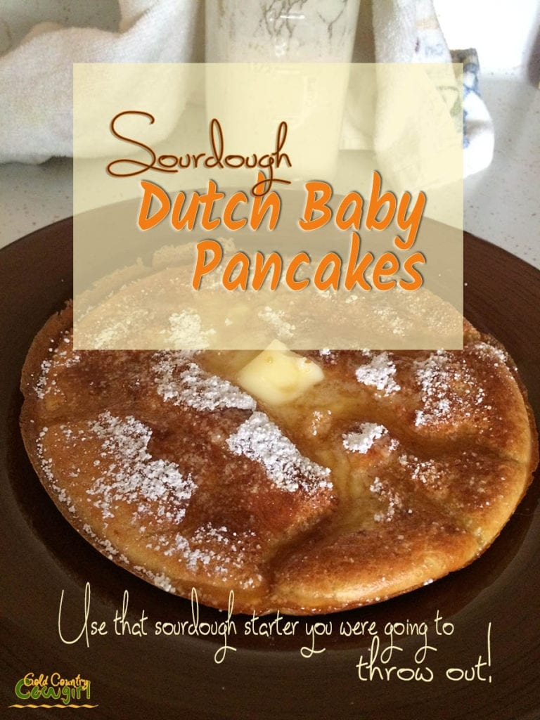 Dutch baby pancake with melted butter and text overlay: Sourdough Dutch Baby Pancakes, Use that sourdough starter you were going to throw out!
