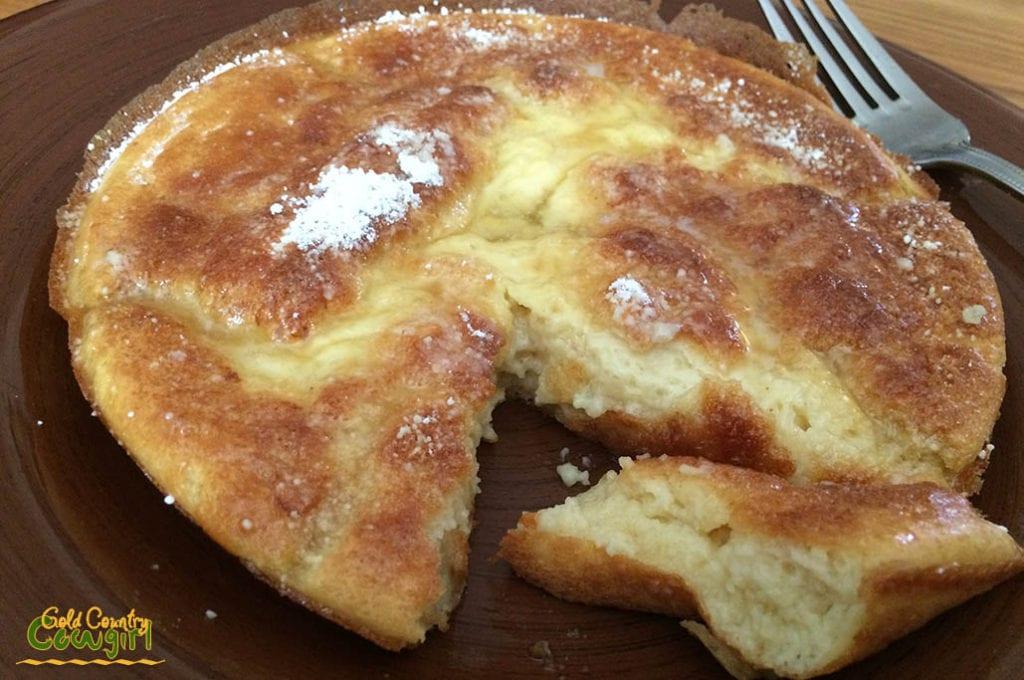 Sourdough Dutch baby pancake with a wedge cut out