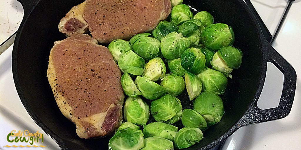 Brussels sprouts added to skillet with pork chops