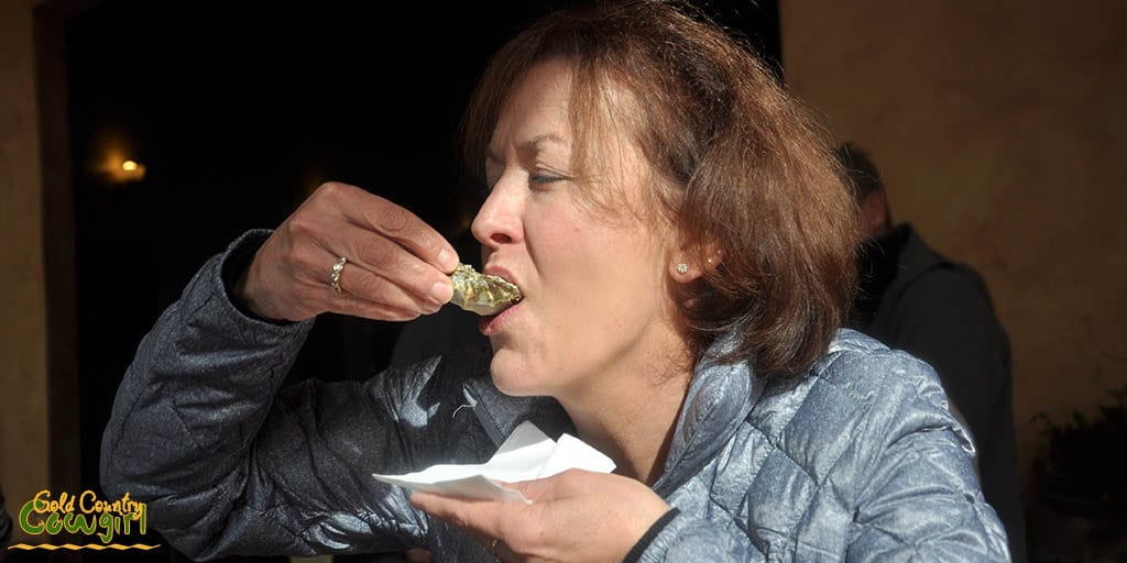Celeste eating another oyster
