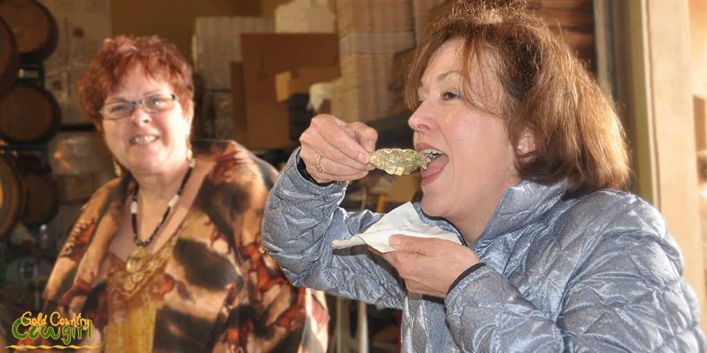 Celeste eating a fresh oyster