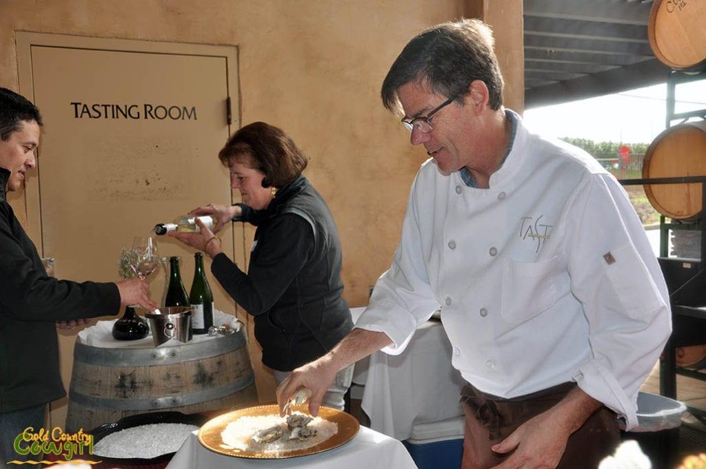 Chef and owner of Taste, Mark Berkner plating oysters