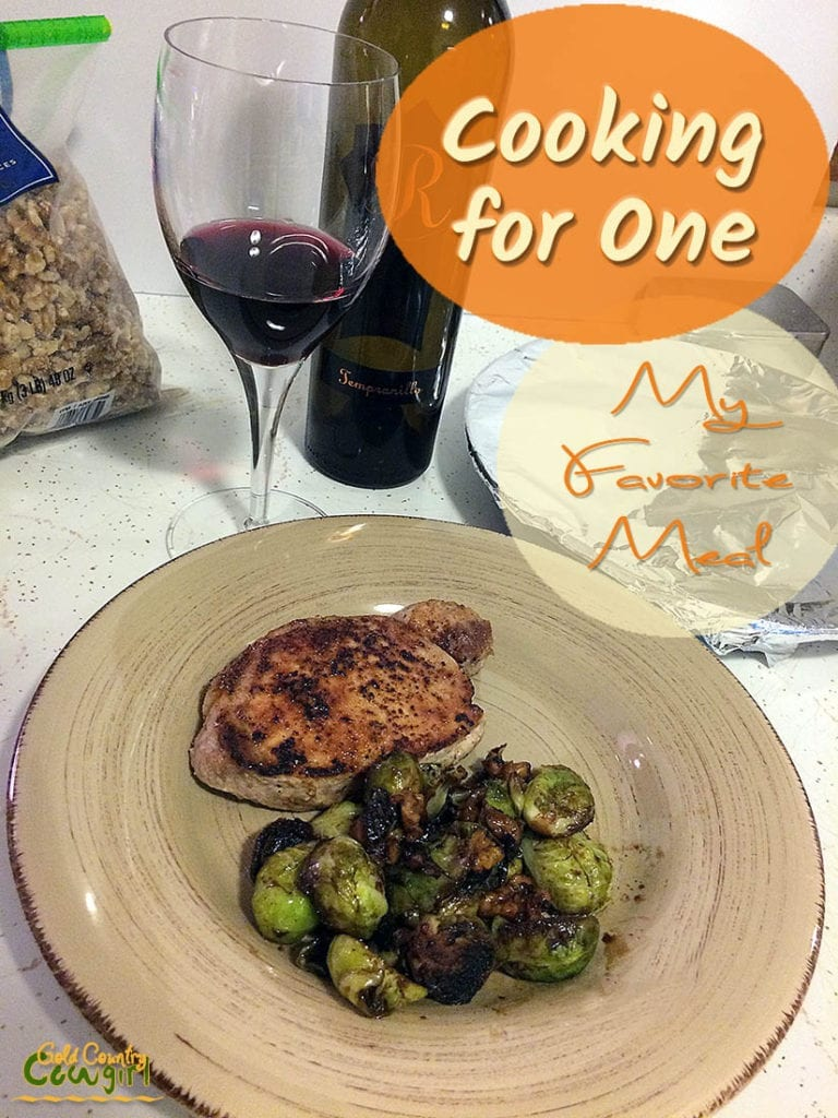 pork chop with brussels sprouts and a glass of wine with text overlay: Cooking for one My Favorite Meal