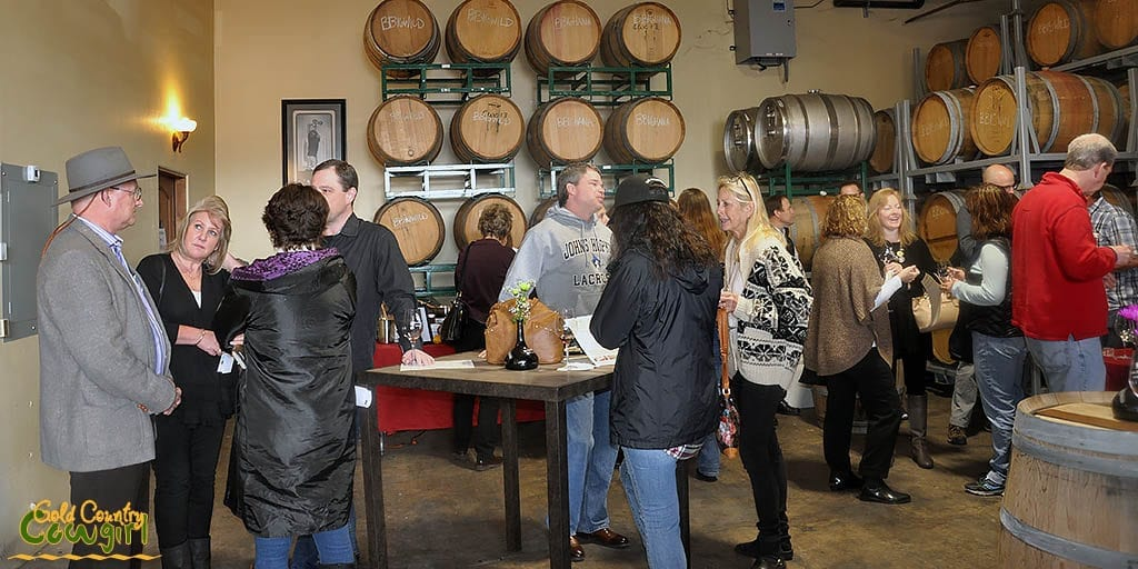 Scott and Jana visiting with club members enjoying the wine and food pairing event