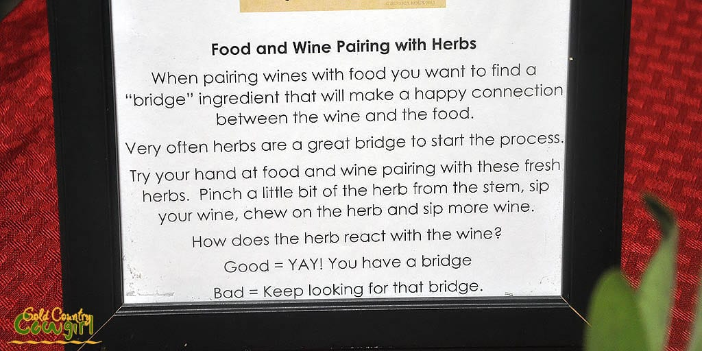 Sign with food and wine pairing with herbs description