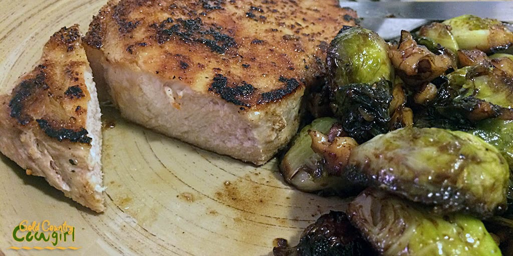 Served pork chop and Brussels sprouts with walnuts
