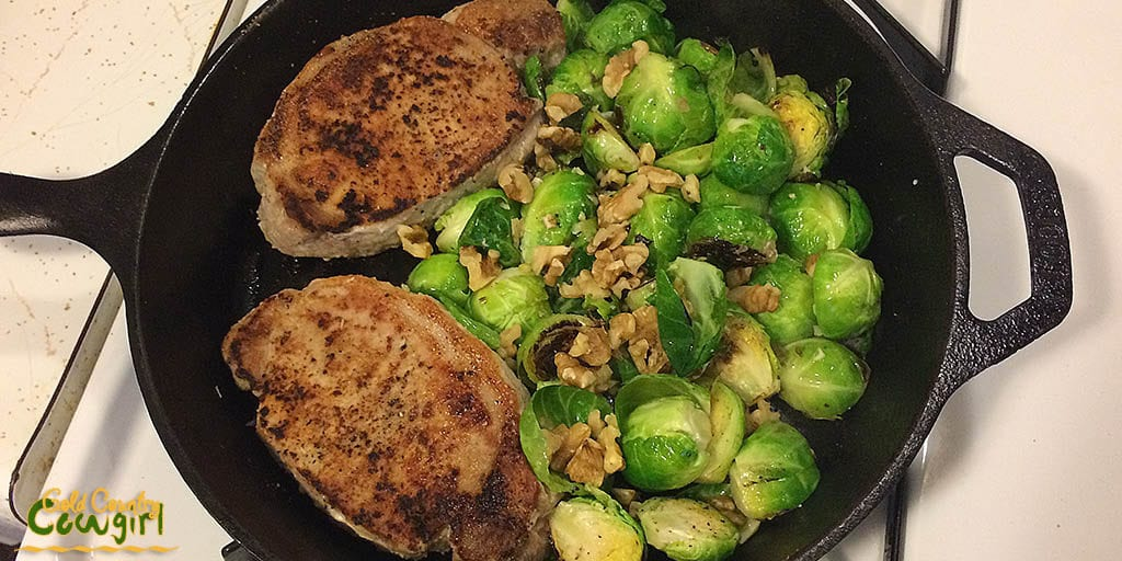 Pork chops and Brussels sprouts with walnuts