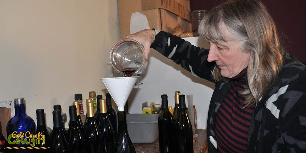 Corinne pouring a blend into a bottle