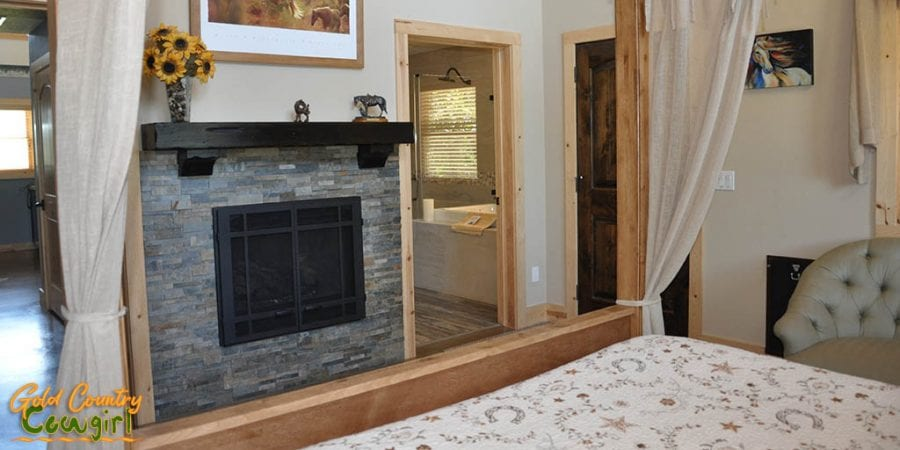 Master bedroom fireplace - Dog & Pony Ranch: Luxurious Gold Country Vacation Rental