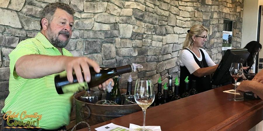 Wine tasting at Wilderotter Vineyards. Sam, co-winemaker pouring.