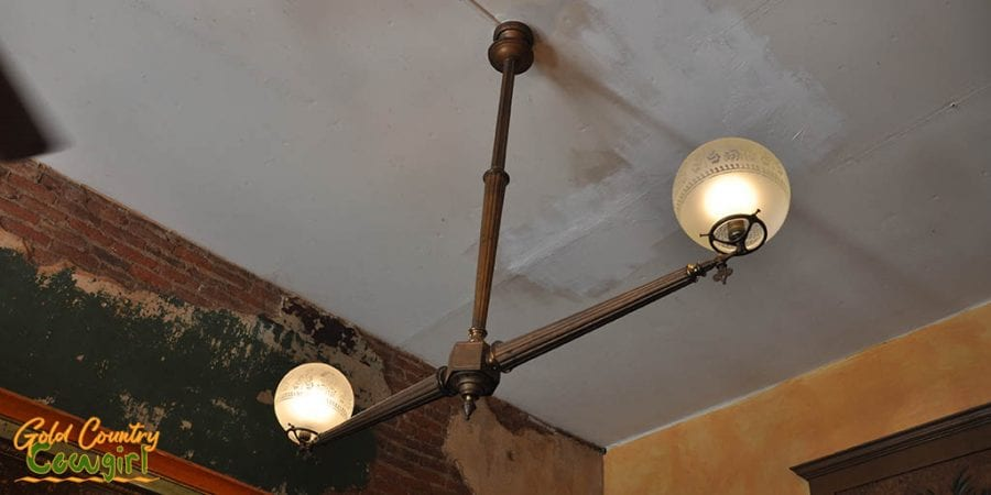 Old gas lights in bar, now converted to electricity