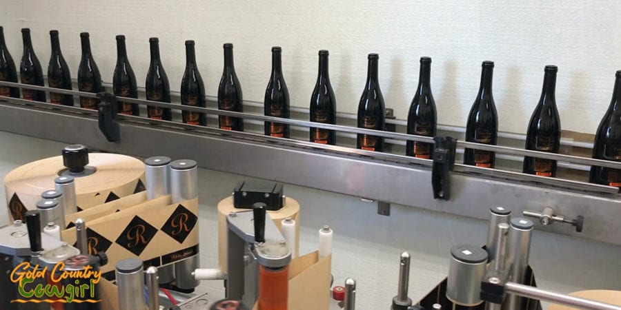 Finished bottles heading out of the mobile bottling truck to be boxed up