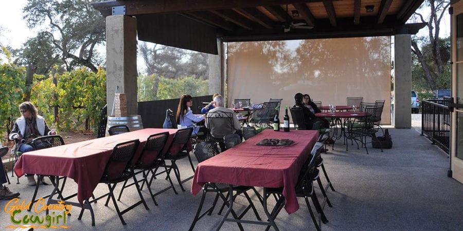 Outdoor patio has screens to block breeze when necessary