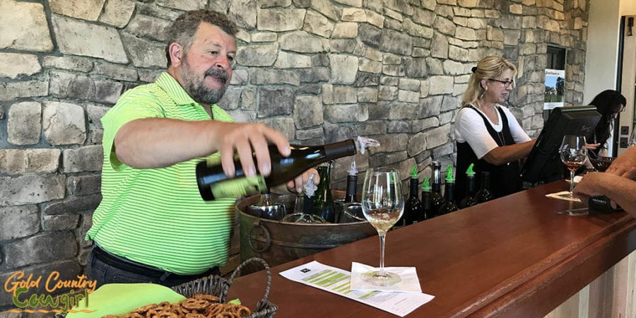 Winemaker Sam pouring in tasting room addition at Wilderotter Vineyard