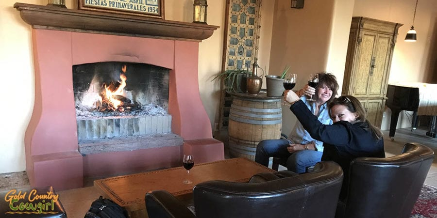 New friends Christy and Sue toasting in front of fireplace at Casa Rondeña Winery