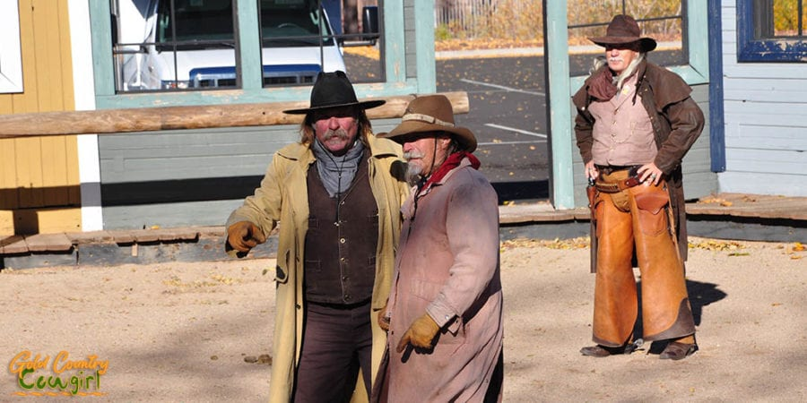 Three cowboys at the shootout prior to boarding the Grand Canyon Railway