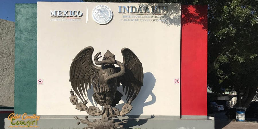 Mexico sign with sculpture of eagle with snake in its beak