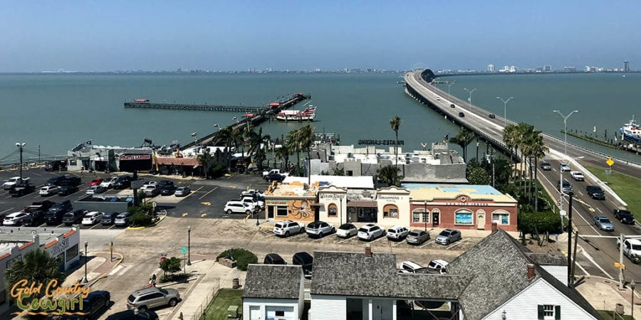 View of Keepers Cottage, part of town square, fishing pier and Queen Isabella Causeway from Port Isabel Lighthouse