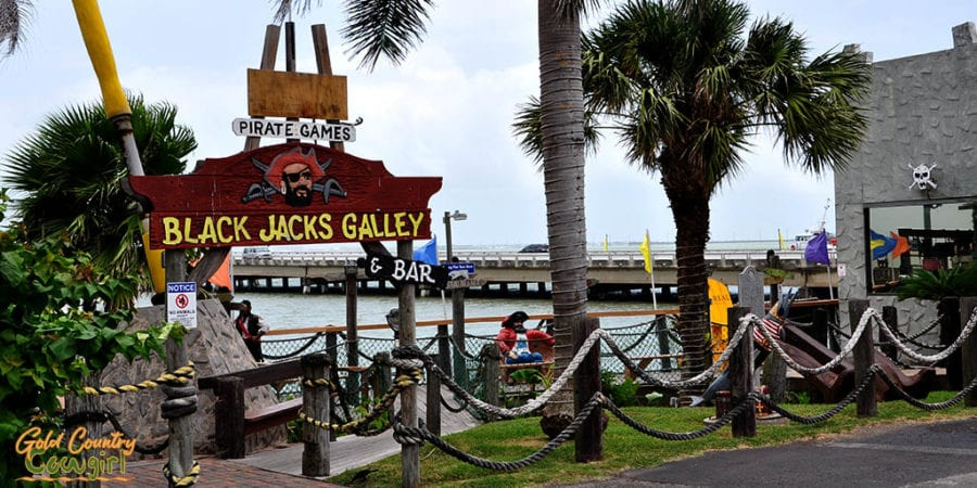 sign Black Jacks Galley & Bar with pier in background