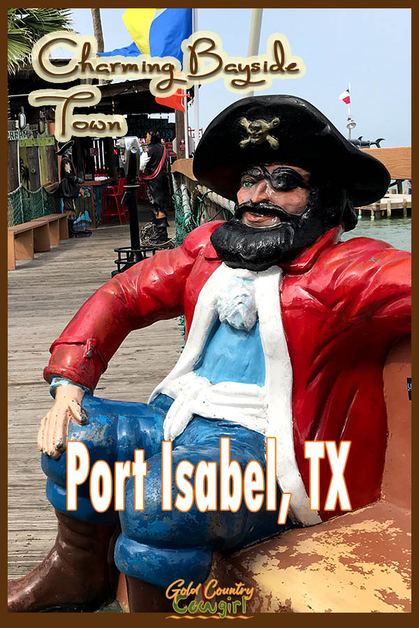 pirate statue on a bench with text overlay: Charming Bayside Town Port Isabel, TX