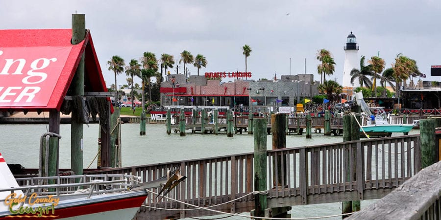 view of Pirate's Landing Restaurant and Port Isabel Lighthouse from pier