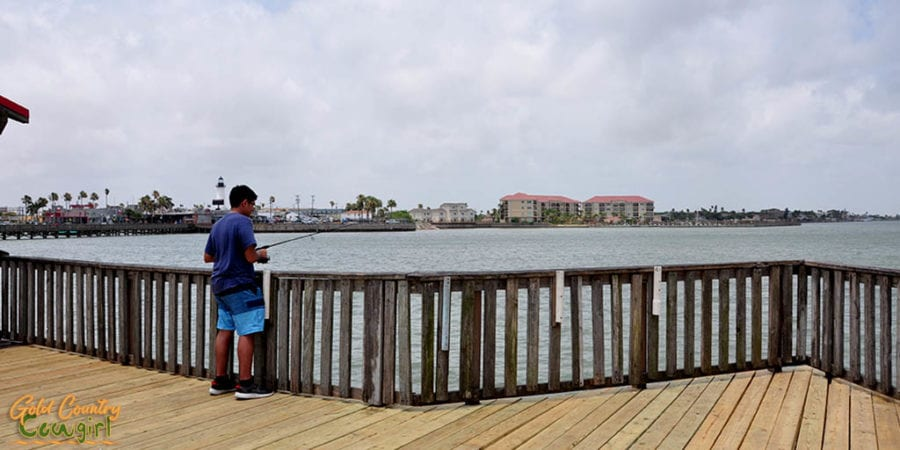 young man fishing on Pirate's Landing Fishing Pier