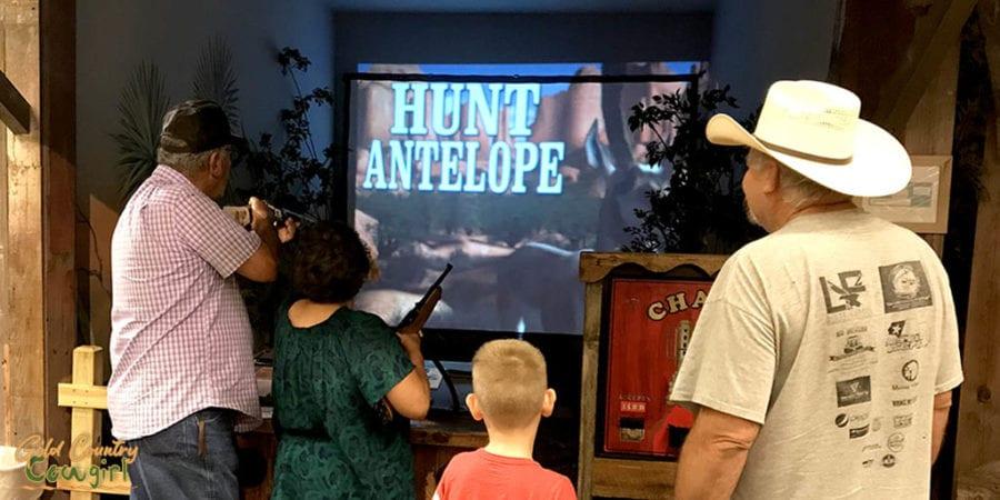 people looking at shooting arcade game - an indoor activity in Harlingen