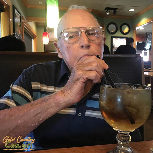man drinking through a straw