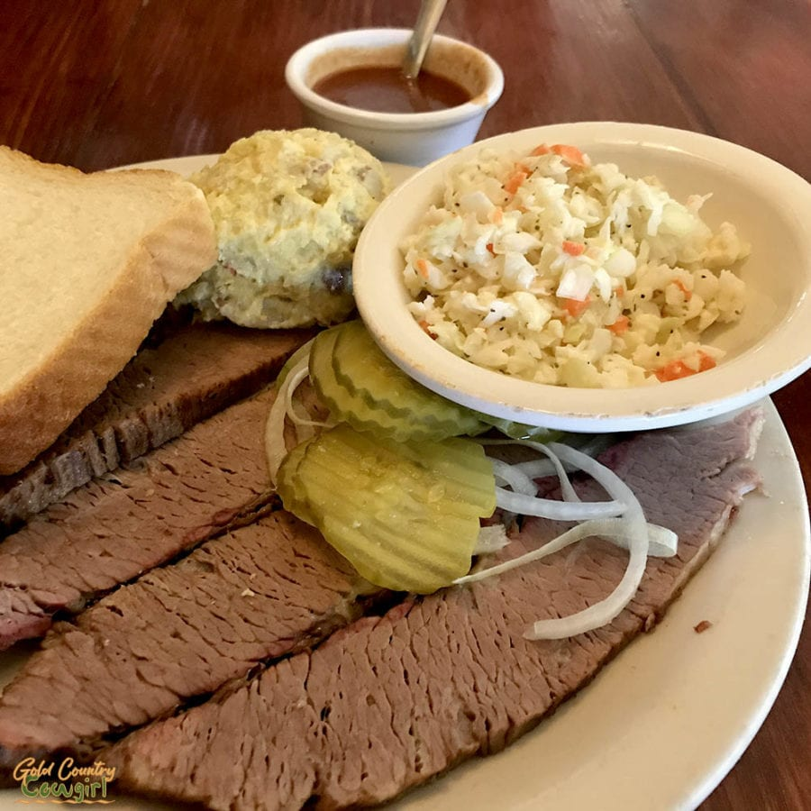 Typical authentic Texas barbecue plate - brisket, coleslaw, potato salad and white bread