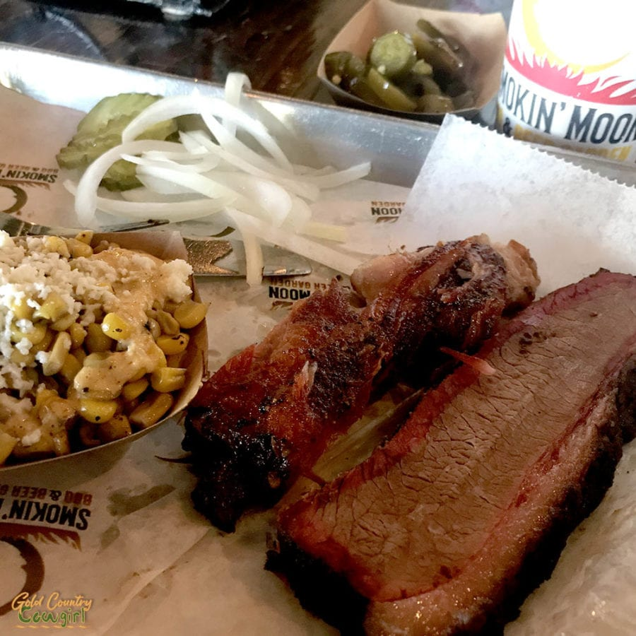 typical authentic Texas barbecue plate with brisket, rib and smoked corn