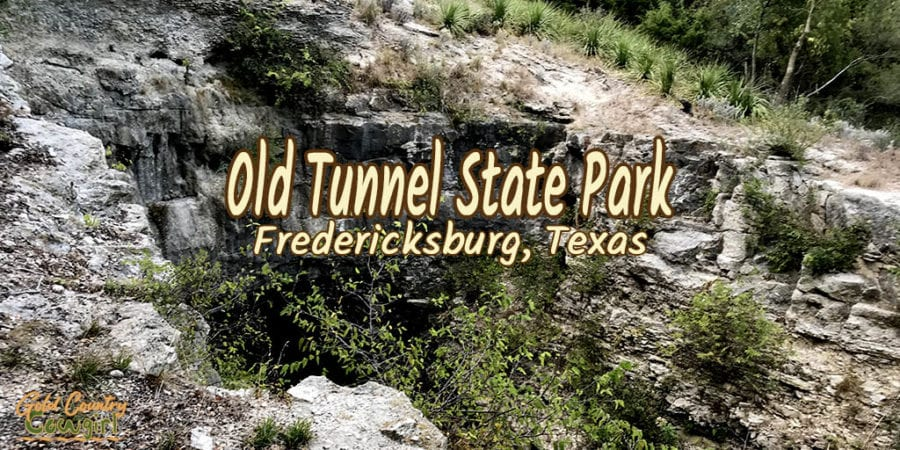 Entrance to tunnel with text overlay: Old Tunnel State Park Fredericksburg, Texas