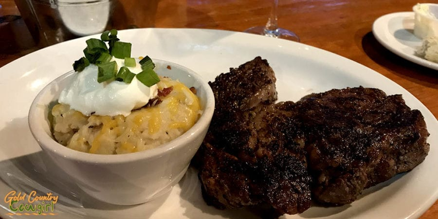 Ribeye and loaded potatoes at Apache Pass Steakhouse