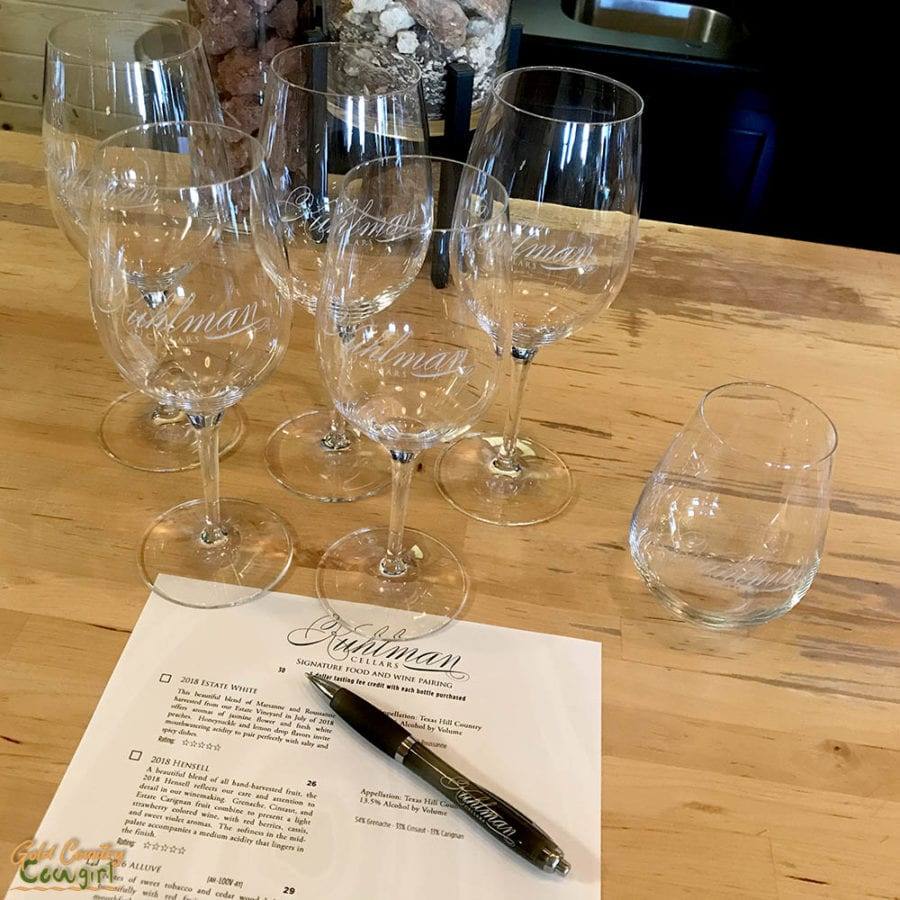 glasses and wine tasting menu at Kuhlman Cellars in Texas Hill Counntry