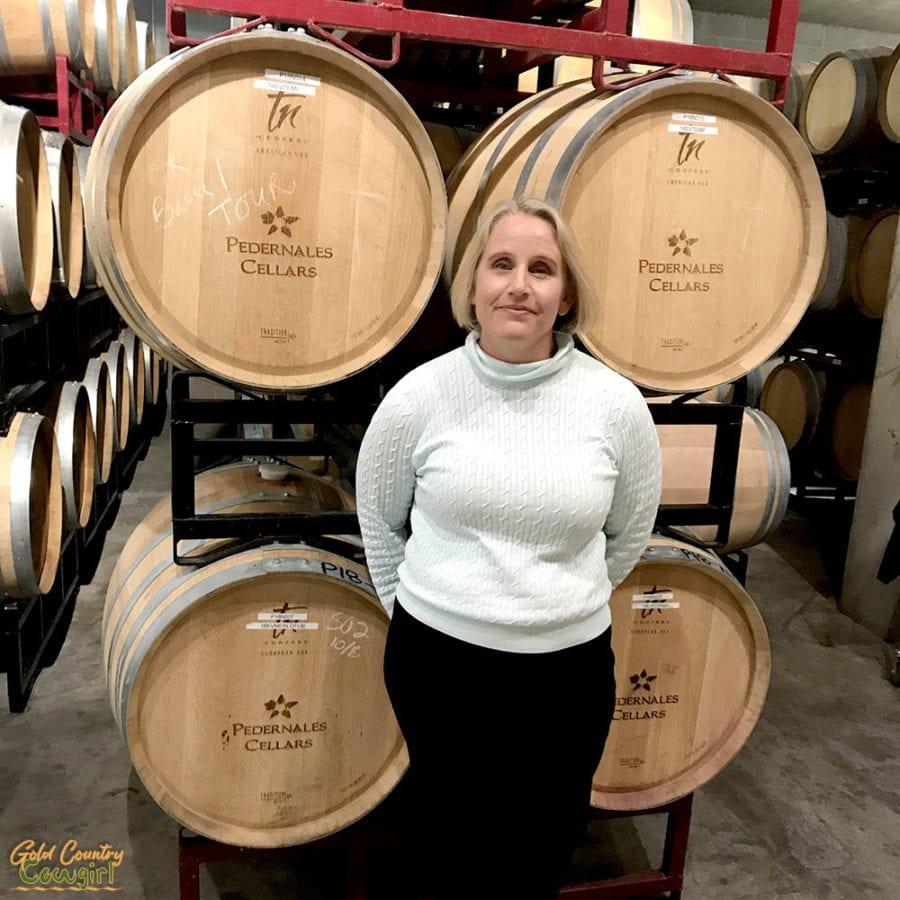 Julie Kuhlken, co-owner of Pedernales Vineyards, in front of barrels
