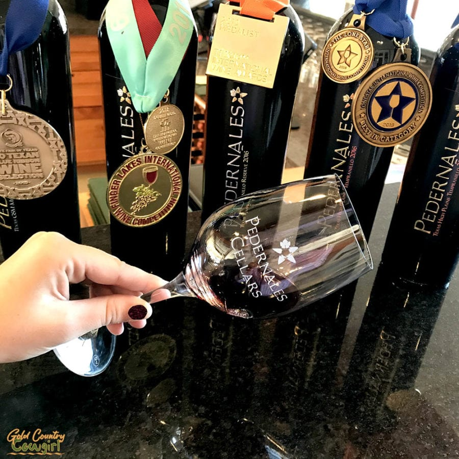 bottles with medals and wine tasting glass at Pedernales Vineyards in Texas Hill Country