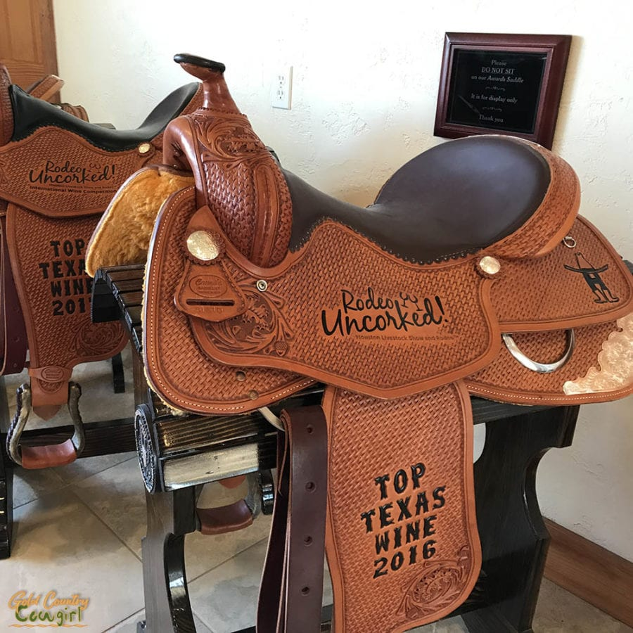 saddle awards in wine tasting room at Pedernales Vineyards in Texas Hill Country