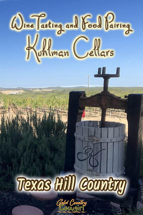 grape press and view of vineyard with text overlay: Wine tasting and food pairing Kuhlman Cellars Texas Hill Country