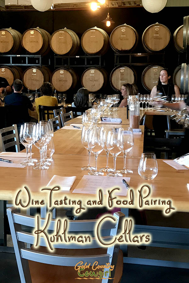 barrel room set up for tasting with text overlay: Wine tasting and food pairing Kuhlman Cellars