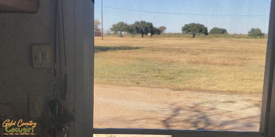 View out trailer door across field