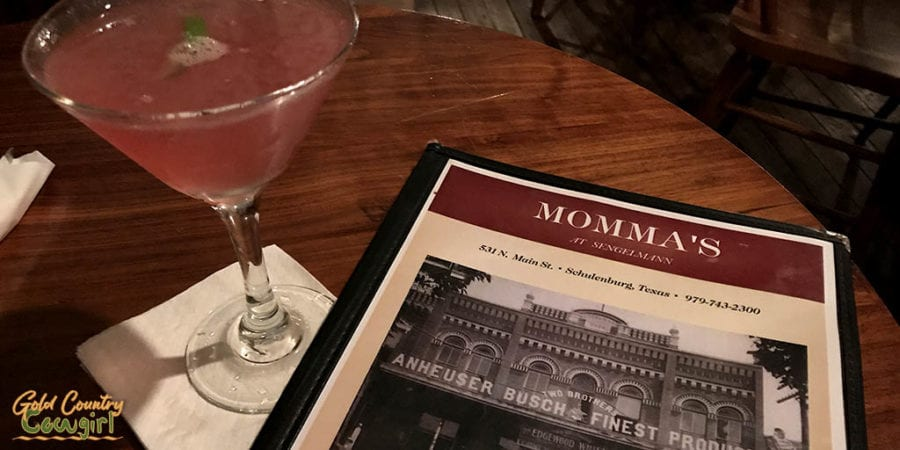 Cosmo and menu at Senglemann Hall, one of the best places to eat in Schulenburg, Texas